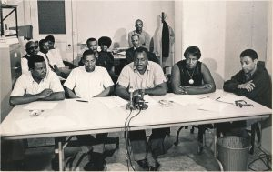 Photo taken of community leaders and organizers during the 1967 Newark rebellion. From left to right: Jesse Allen (UCC), James Hooper (CORE), Donald Tucker (CORE), Marion Kidd (People's Action Group), and Phil Hutchings (SNCC). --Credit: Newark Public Library