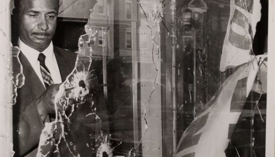 Photo of Earl Harris Inspecting Damage to his Store (C-108)-min