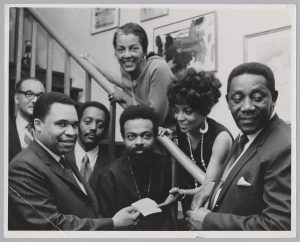 Ken Gibson poses for a photo with Theodore Pinckney, Amiri Baraka, and others during his mayoral campaign. The potential to elect the first Black mayor of a major northeastern city drew national attention to Newark and Amiri Baraka used his connections to bring celebrity supporters to the city for Gibson's campaign.