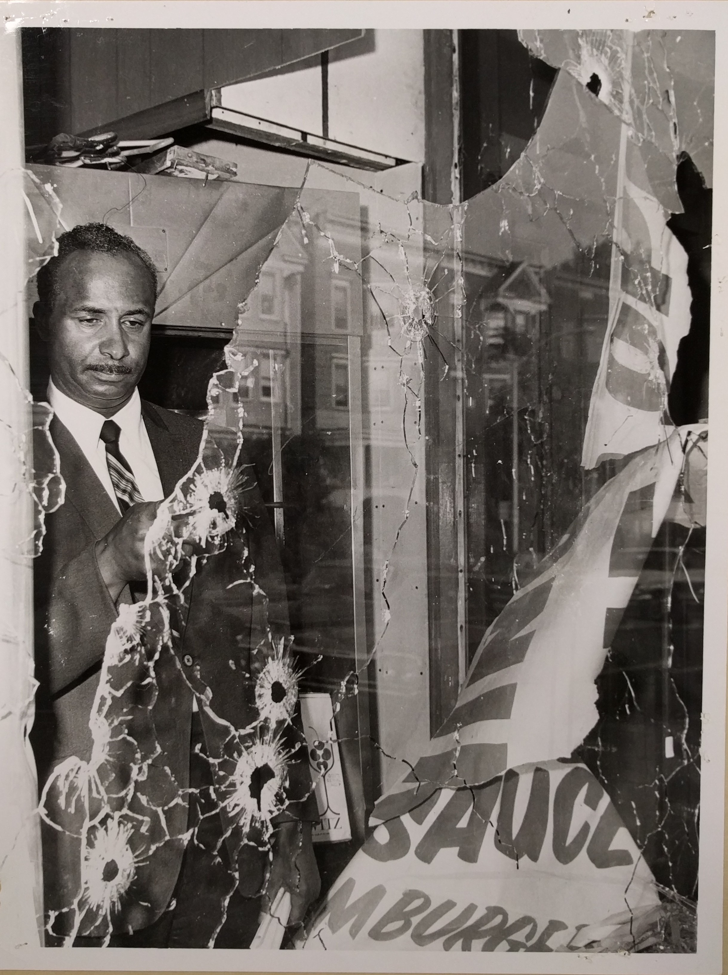 Earl Harris Examines the Damage to His Store