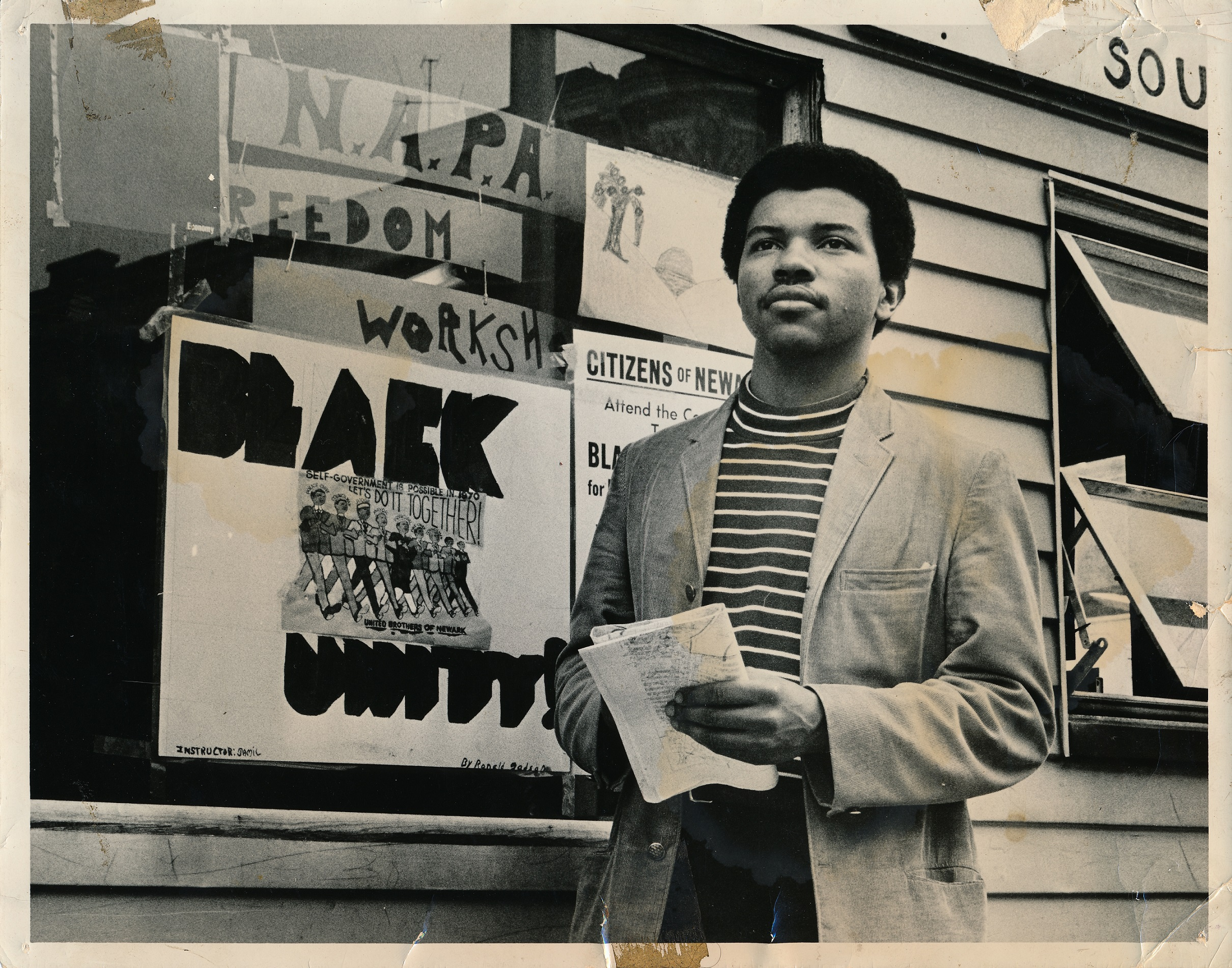 Photo of Junius Williams in front of NAPA Office