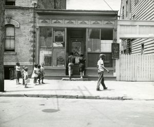 View of a storefront church in Newark. Countless storefront churches popped up in northern cities in the 20th century as African American populations left the South during the Great Migrations. -- Credit: WPA Photographs, NJ State Archives