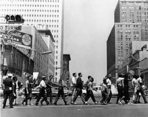 Photograph of a march held by the Newark Community Union Project (NCUP) to protest police brutality after the killing of Lester Long by Newark policeman Henry Martinez. The shooting of Lester Long was one of the most well-known and contentious cases of alleged police brutality in Newark during the 1960s and reinvigorated community demands for a police review board. -- Credit: Doug Eldridge Collection