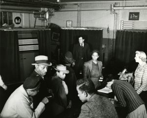 A look inside a polling station at Newark's Prince Charlton School in the early 1930s, as African Americans turned out to cast their votes. A new political awareness in Newark's African American communities began to grow at the turn of the 20th Century, and the 1920s through 1940s saw the beginning of black political power on the local scene. -- Credit: WPA Photographs, NJ State Archives