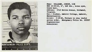 Mugshot of Junius Williams from a Montgomery jail in 1965. Williams was arrested in Montgomery, Alabama during the Selma-to-Montgomery March in 1965. -Credit: Junius Williams Collection