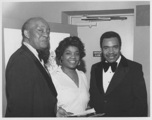 Photograph taken at the New Jersey State Opera of Harry Wheeler, Larrie West Stalks, and Mayor Ken Gibson in the 1970s. (Newark Public Library)