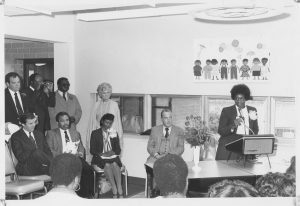 Mary Smith (right) addresses a community meeting, as Mayor Ken Gibson (seated, second from left) and others look on and listen. --Credit: Newark Public Library