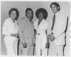 Photograph of (left to right) Sally Carroll, Mayor Ken Gibson, Patricia Tate, and an unidentified man taken during Gibson's administration. Carroll served as president of the Newark Branch of the NAACP during Gibson's first term. --Credit: Newark Public Library