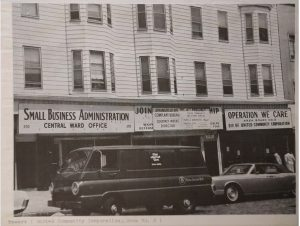 """View of the storefront office of United Community Corporation Area Board #2, """"Operation We Care"""" at 415 Springfield Avenue. Edna Thomas was active in Area Board #2 and served as its Vice President for a time. --Credit: Newark Public Library"""