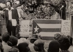 A speaker addresses a crowd during a Puerto Rican rally against police brutality in September of 1974. --Credit: The Daily Worker, NYU Tamiment Library
