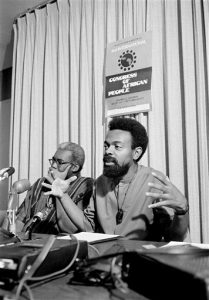 "Black poet, Imamu Amiri Baraka, who wrote under the name of LeRoi Jones, announces plans for a second International Congress of Black People at a press conference in New York, Aug. 16, 1972. The congress will be held in San Diego, Calif., Aug. 31 through Sept. 4. Baraka also called for a ""unity of African people"" for the purposes of collective political power. (AP Photo/Ron Frehm)"
