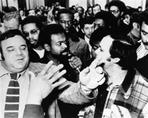 Assemblyman Anthony Imperiale and poet Imamu Amiri Baraka (holding microphone) both arrive at a meeting regarding the Kawaida Towers housing project on Nov. 10,1972 in Newark. (AP Photo)