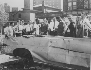 Willie Wright (center) leads a group of Newark businessmen on a tour of the city's Central Ward in 1968. Wright, head of the United Afro-American Association, led tours of the Central Ward to demonstrate the conditions faced by its predominantly Black residents, and to promote investment in the area. -- Credit: Newark Public Library