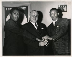 "(L-R) George Richardson, Dennis Carey, and Eulis ""Honey"" Ward pose for a photo in the 1960s. -- Credit: Newark Public Library"