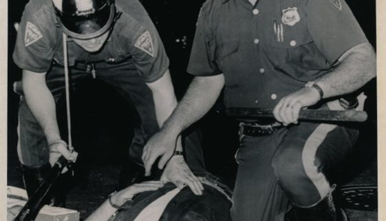 Police Attend to Injured Officer